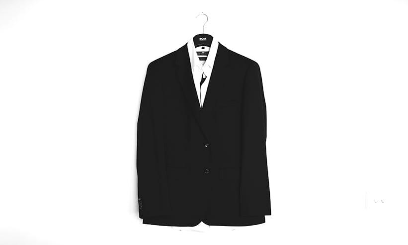 壁に掛けられたスーツ
